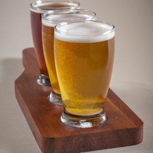 custom beer flight paddles with three beer glasses