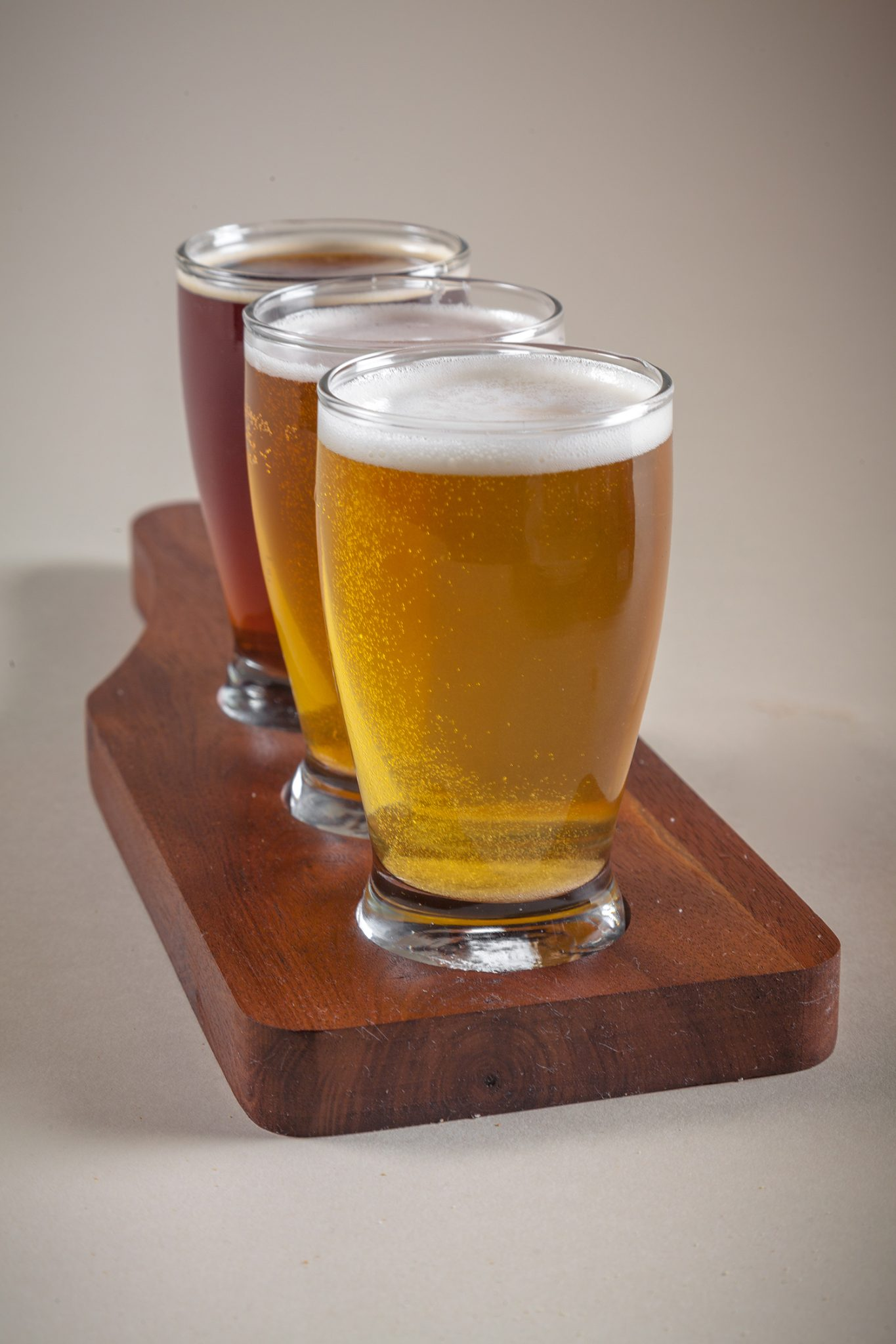 custom beer flight paddles with three beer glasses