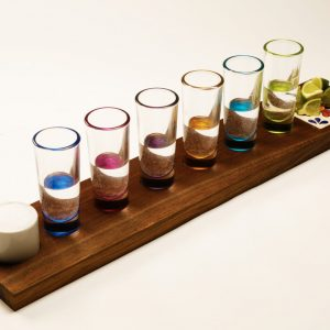 tequila flight boards with colorful shot glasses